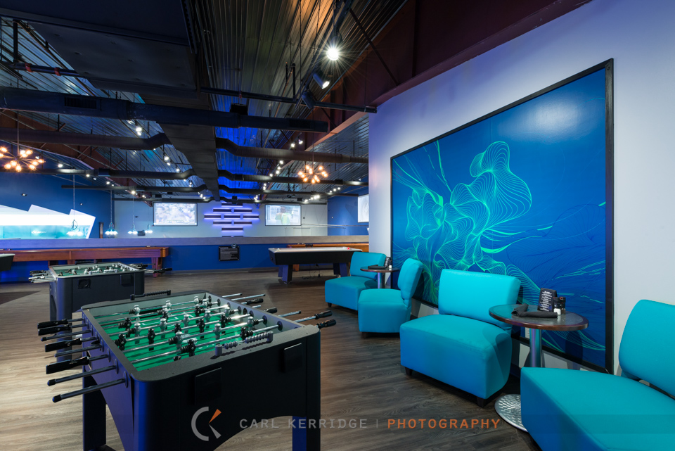 Lifestyle photography of the games area at 710 Bowling Alley, interior designs by e3 studios