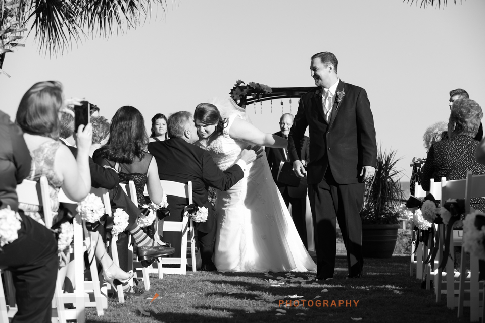 Myrtle Beach Wedding Photographer, Photojournalism, BW Wedding Image, Breakers Resort, Ceremony, Kiss Daddy
