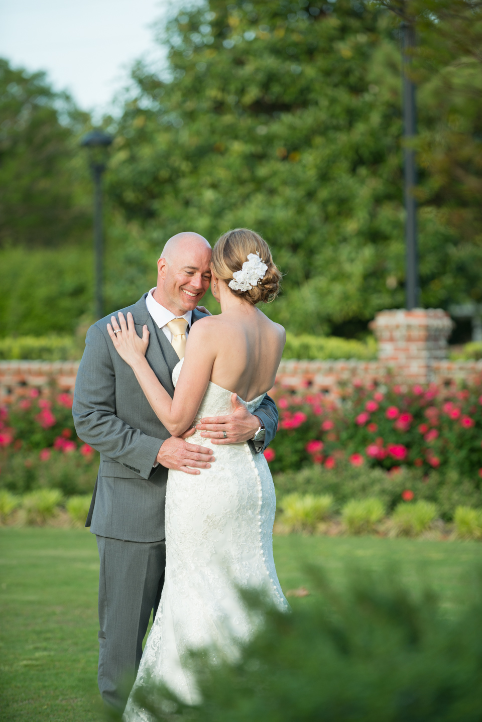 outdoor portrait, romantic wedding couple embrace