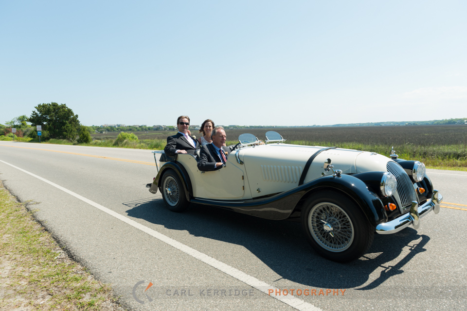 Marries couple cruising in an old Morgan across the Inlet in Litchfield Beach
