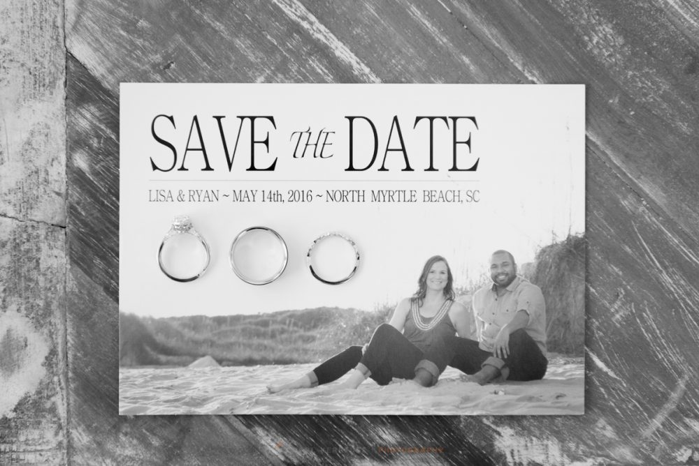 save the date invitation from the bride and groom with there wedding rings placed on top for a black and white image