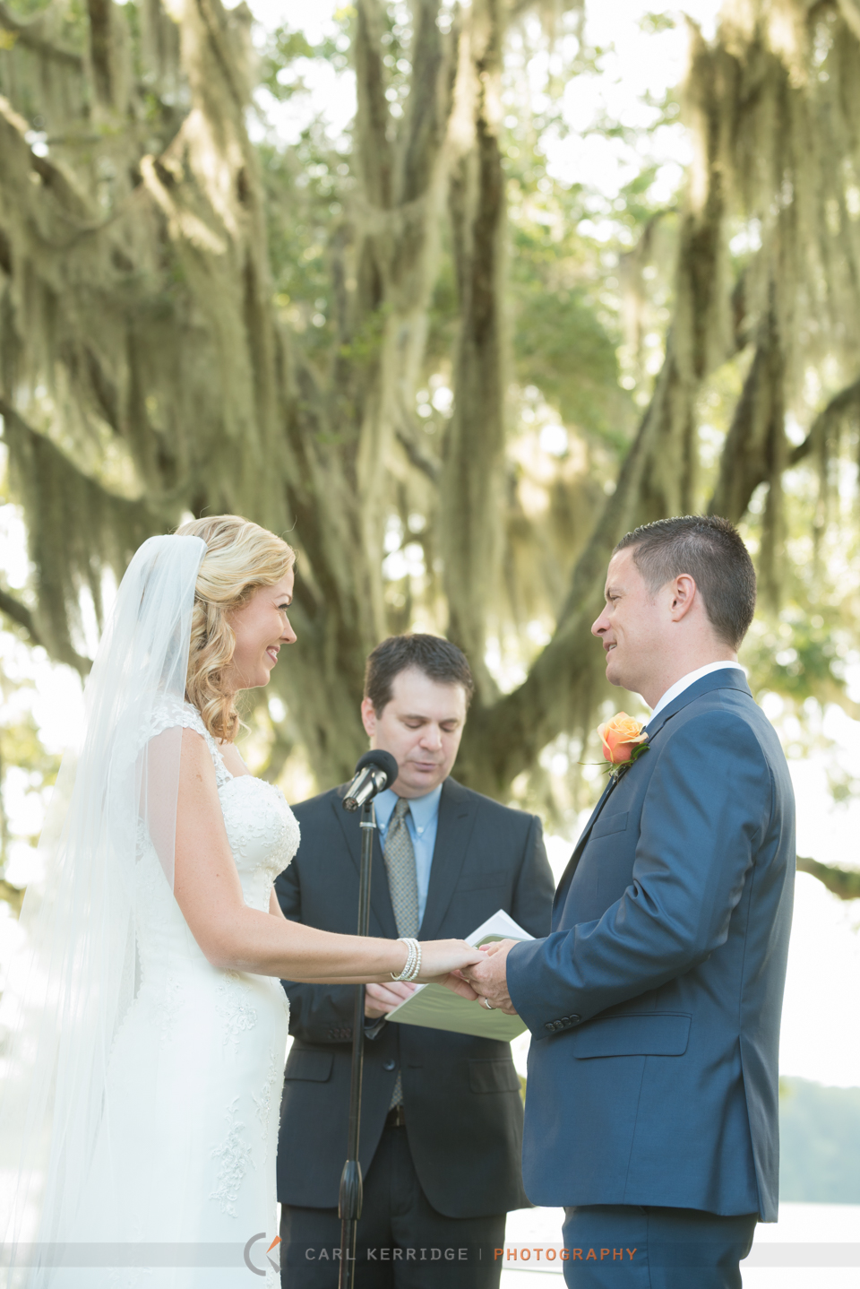 Bridal ceremony at Wachesaw Plantation under the live oaks and spanish moss