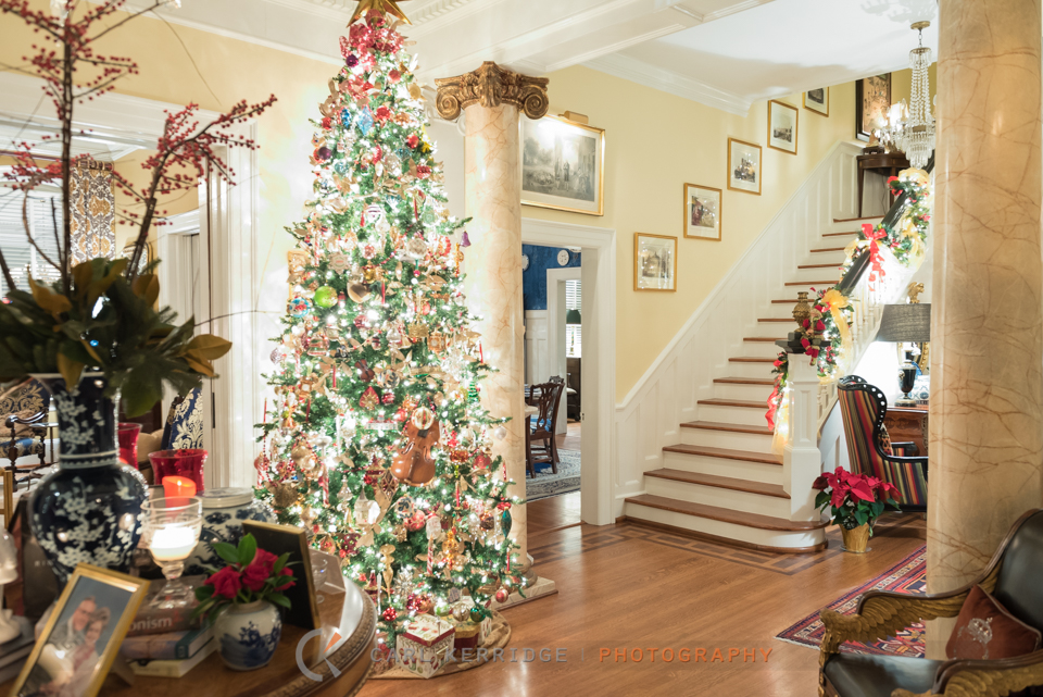 an interior shot of the downstairs parlor at Rosewood Manor, decorated with a beautiful christmas tree and decorations